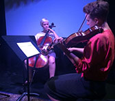 Nikki Edgar (cello) and Mirren Strahen (violin) performing at the 2016 Tilde Festival