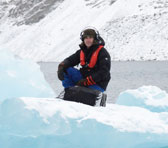 Daniel Blinkhorn recording on a small iceberg