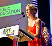 Erica Byrne accepting the Award for Excellence in Music Eduction for Gondwana Choirs