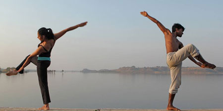 Meghna Nambiar and Sylvester Mardi, two dancers against the still water of the damn in the Narmada Valley
