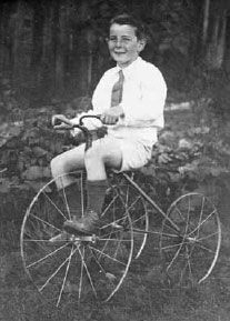 Tribe riding a bike at age 7 approx.