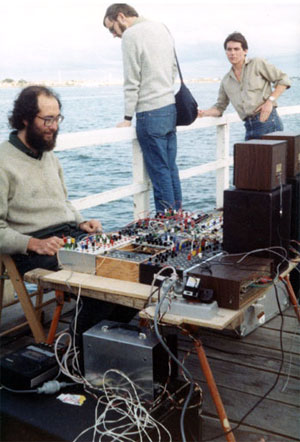 Warren Burt: Natural Rhythm 1983. Hydrophone, water gongs, Serge, Driscoll and home-brew modules, Gentle Electric Pitch to Voltage, Auratone Loudspeakers. St. Kilda Festival, St. Kilda Pier, Melbourne.