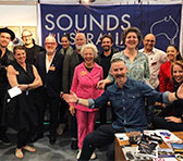 "Australian delegates assembled at Jazzahead (<a href=""http://micnet-cdn.s3.amazonaws.com/images/resonate/SA-jazzahead-stand-2019-big.jpg"" target=""_blank"">larger view</a>)"